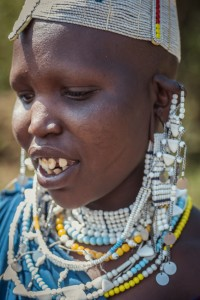 Portrait of young masai woman, beauty in poverty and reason to solve poverty